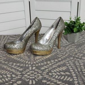 Jennifer Lopez gold platform stilettos.